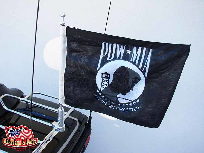 Motorcycle Flagpole With POW MIA Flag mounted on a Harley Davidson motorcycle luggage rack
